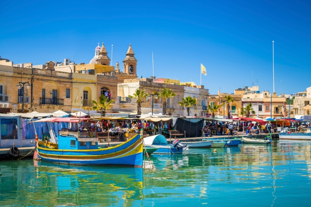 Marsaxlokk market with traditional Luzzu fishing boats